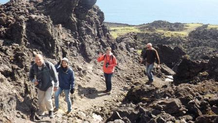Hikers at the 1961 eruption ruins.